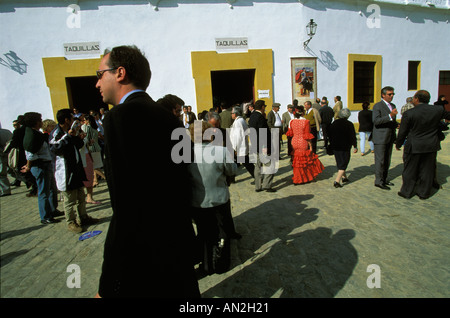Spectators on their way to a bullfight on the Maestranza Bullring during the April Fair of Seville Andalucia Spain - Stock Photo