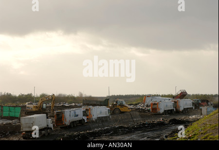 Refuse lorries wait in line at a landfill site, Irvine, Scotland. Waste management is on of the major issues facing - Stock Photo