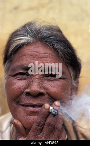 Friendly elderly vendor smoking a cheroot Market Pyin U Lwin Maymyo Central Burma - Stock Photo