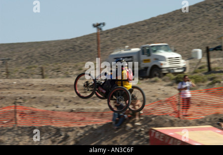 4 wheel mountain bike wheel chair jumping - Stock Photo