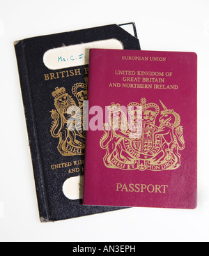 New and old style United Kingdom passport with the older one cancelled by cutting off a corner - Stock Photo