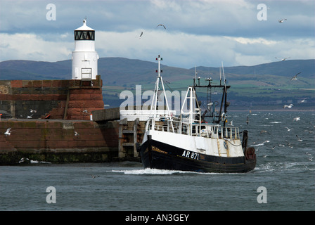 Fishing Boat Returning To Troon Harbour Ayrshire Scotland UK - Stock Photo
