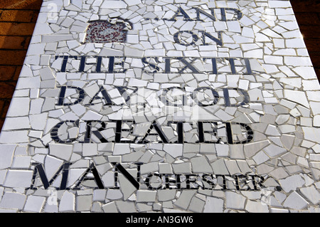 and on the sixth day god created manchester man white black tiles wall biblical reference pun words literature street - Stock Photo