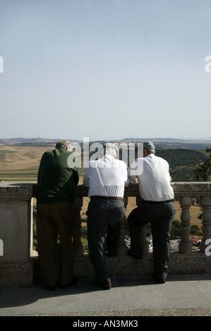 Men talking whilst looking out on Spanish landscape - Stock Photo
