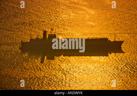 A container ship leaving Hong Kong in the South China Sea. - Stock Photo