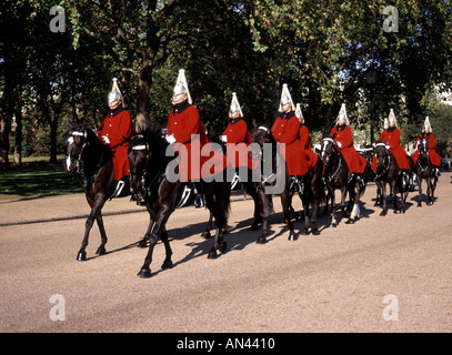 London troopers of Household Cavalry Mounted Regiment The Life Guards arriving on Horse Guards for changing the - Stock Photo