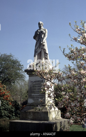 City of Southampton statue of Lord Palmerston with Magnolia tree in bloom in local park - Stock Photo