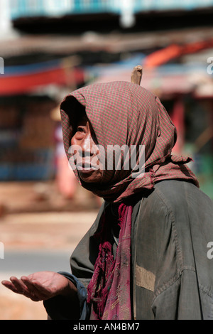 Beggar holding out her hand for donations, Aungban, Shan State, Burma, (Myanmar) - Stock Photo