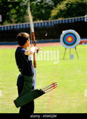 Boy shooting arrow in the London Youth games archery competition held at Crystal Palace. Bromley, Kent, England, - Stock Photo