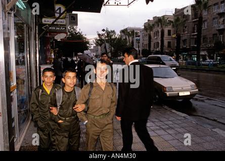 Schoolchildren on pavement, Damascus, Syria - Stock Photo