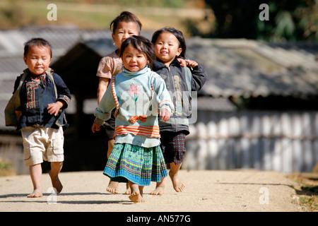 Black Hmong Children in a small village near Sapa - Stock Photo