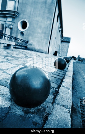 Iron balls and building in the background in Antibes France Shallow D O F Blue tone - Stock Photo