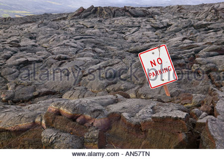 A 'no parking' sign pokes out from a lava flow in Volcanoes National Park on the 'Big Island' of Hawaii. - Stock Photo