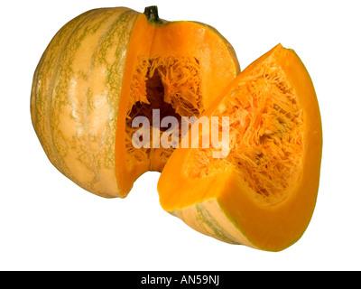 big round orange pumpkin sliced in a quarter - Stock Photo