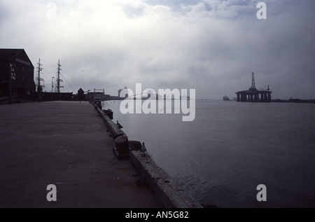 Offshore Drilling Rig, Texas Seaport Museum and Elissa Official Tall Ship of Texas, in the fog, Port of Galveston - Stock Photo