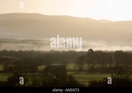 early morning mist in the upper teifi river valley looking towards Cors Caron nature reserve near Tregaron Ceredigion - Stock Photo