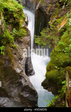 Small waterfall near Pont Romain, Les Contamines-Montjoie, France - Stock Photo