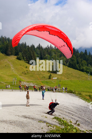 Paraglider taking off from Plaine Joux, French Alps, France - Stock Photo
