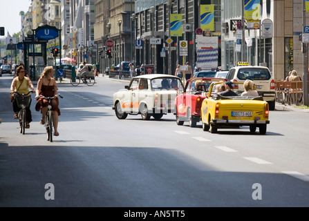 Sightseers in Trabant cars take a tour of Berlin, Germany - Stock Photo