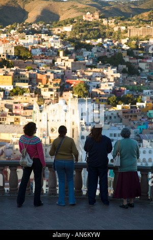 MEXICO Guanajuato Four women at overlook have aerial view of city from el Pipila overlook University of Guanajuato - Stock Photo