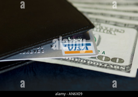 credit card and US dollar notes coming out of a wallet - Stock Photo