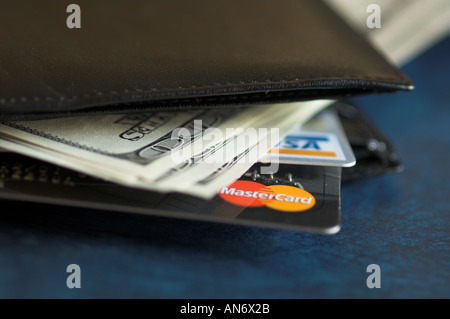 credit card coming out of a wallet - Stock Photo