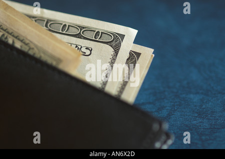 US dollar notes coming out of a wallet - Stock Photo