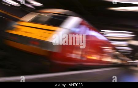A Virgin Trains Pendolino passenger train in Euston Station London  - Stock Photo