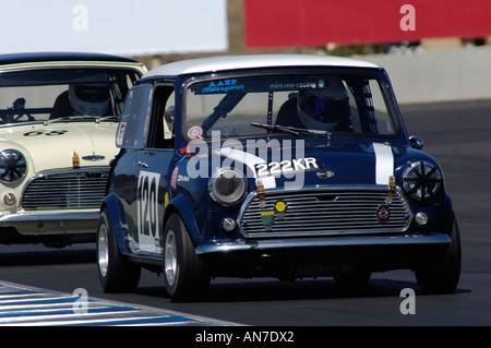 Two Austin Mini Coopers race at the 2006 Rolex Monterey Historic Automobile Races - Stock Photo