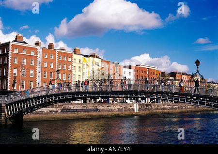A view along the River Liffey with Ha Penny Bridge crossing it seen from Wellington Quay on a bright sunny day Colourful - Stock Photo
