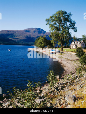 Ben Lomond rises in the distance beyond Loch Lomond Argyll and Bute - Stock Photo