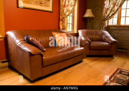 warm living room furnitures and decor in Quebec, Canada - Stock Photo