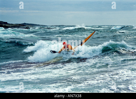 Advanced sea kayaking goes beyond comfortable paddling on placid waters on a sunny summer day Orost Bohusland Sweden - Stock Photo