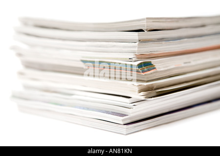 Close up on a bunch of magazines. White background. - Stock Photo