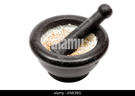 Grinding wheat grains. Isolated on a white background. - Stock Photo