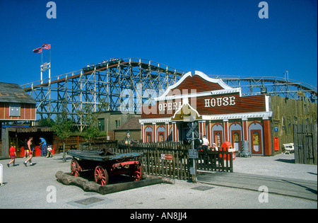 Old western decorations of Frontierland Theme Park amusements Rollercoaster can be seen beyond Old signs and opera - Stock Photo