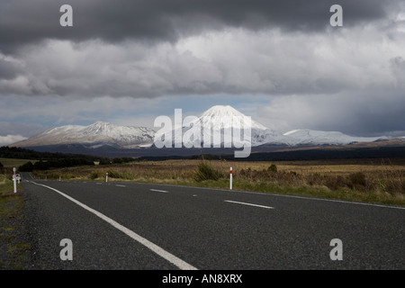 View of a snow covered Mount Ngauruhoe volcano taken from the Desert Road, New Zealand - Stock Photo