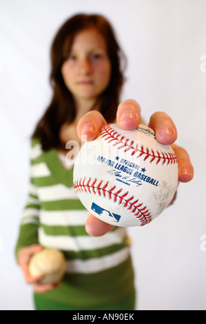 Young girl fan holding an official Major League Baseball signed ball collectors item - Stock Photo