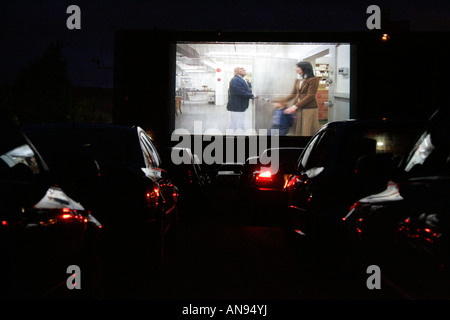 cars in a drive though cinema at night watching The Shining - Stock Photo
