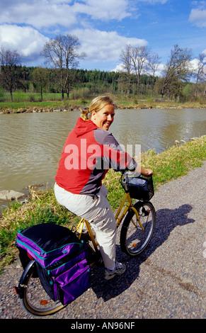 Female cyclist along the Göta Kanal Channel, Östergötland, Sweden - Stock Photo