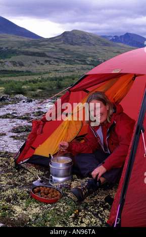 Woman cooking food inside tent Rondane Norway - Stock Photo  sc 1 st  Alamy & Woman cooking food at the tent. Rondane Norway Stock Photo ...