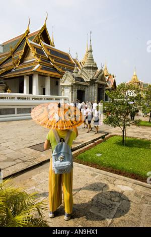Tourists visit the Amarin Winitchai Throne Hall Bangkok Thailand - Stock Photo