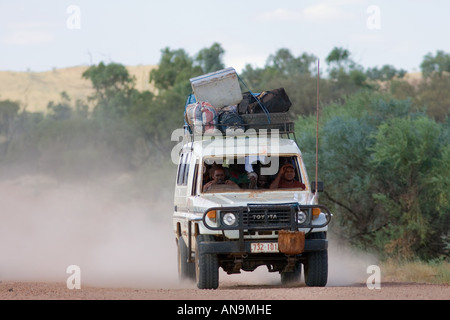 Four wheel drive vehicle on the Mereenie Loop Road West Macdonnell National Park Red Centre Australia - Stock Photo