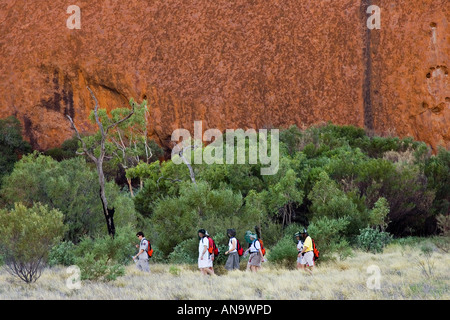 Tourists at the base of Ayers Rock Uluru Red Centre Australia - Stock Photo