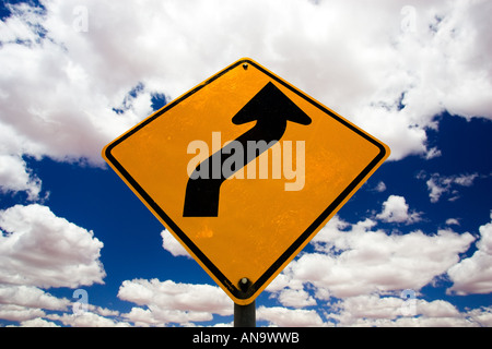 Road Sign warning of bends in road Red Centre Australia - Stock Photo