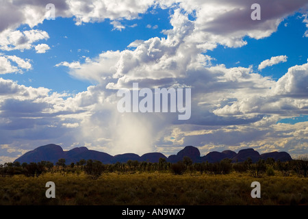 Sun s rays above The Olgas Kata Tjuta Red Centre Northern Territory Australia - Stock Photo