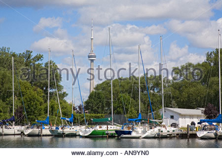 Royal Canadian Yacht Club and CN Tower fron Toronto Islands Park in Toronto Ontario Canada - Stock Photo