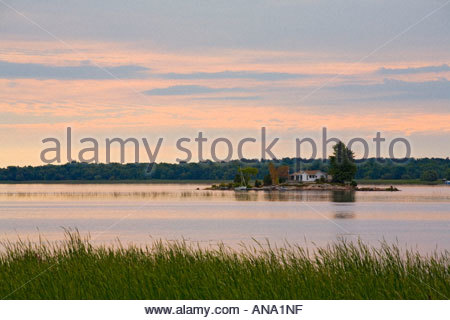 Summer home at sunrise in the 1000 islands area of the Saint Lawrence River in Ontario Canada - Stock Photo