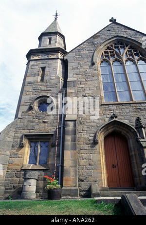 a shiny new copper lightning conductor on a church - Stock Photo