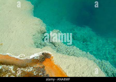 Closeup of the Beautiful Blue Water of The Black Pool Spring at West Thumb Geyser Basin in Yellowstone National - Stock Photo